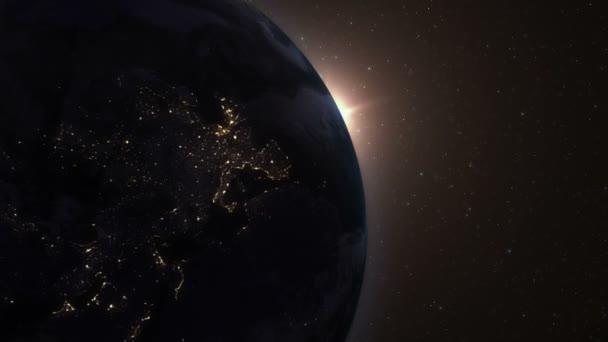 Východ slunce nad zemí. Úžasný pohled planety země z vesmíru