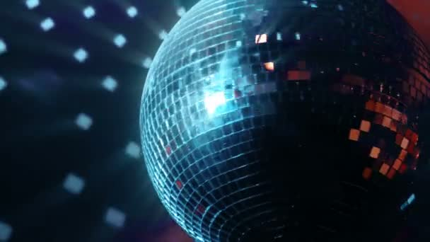 A beautiful shiny spinning disco ball in red blue