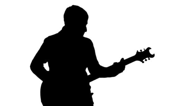 Egy ember, játszik a gitár, fehér alapon fekete sziluettje