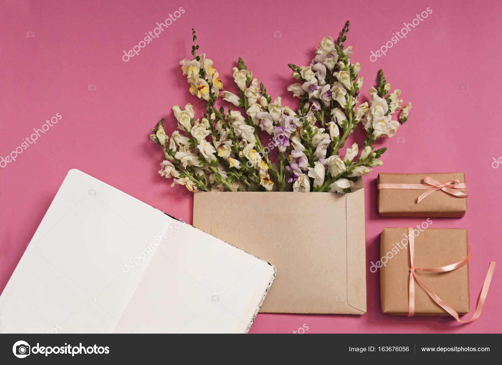 Flowers composition gifts heart shaped flowers envelope pink flowers composition gifts heart shaped flowers envelope pink background flat stock photo mightylinksfo