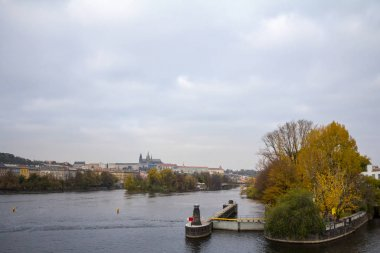 Panorama of the Old Town of Prague, Czech Republic, with a focus on Charles bridge (Karluv Most)  and the Prague Castle (Prazsky hrad) seen from the Vltava river. The castle is the main touristic landmark of the city