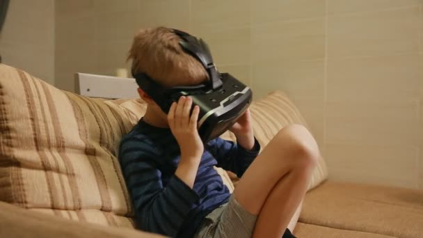 6ae32d8b8bc7 Boy 6-7 years playing at home with the help of virtual reality goggles  video games. Close-up– stock footage