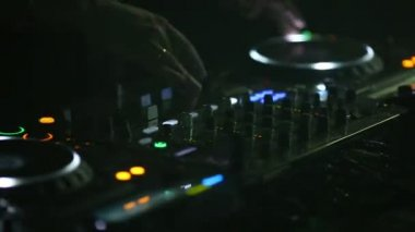 DJ working night clubs for remote control sound control.