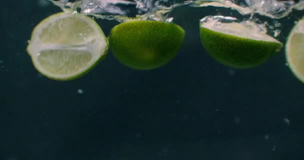 Lime Thrown Into The Water With Splash.