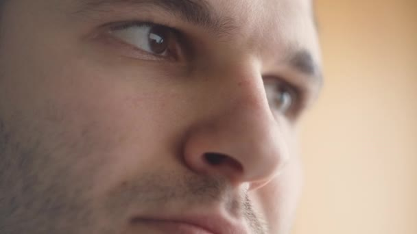 Close-Up Of The Eyes And Face Of A Young Man Working At A Computer.