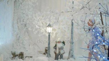 Little girl in suit snow maiden walks in fairy forest