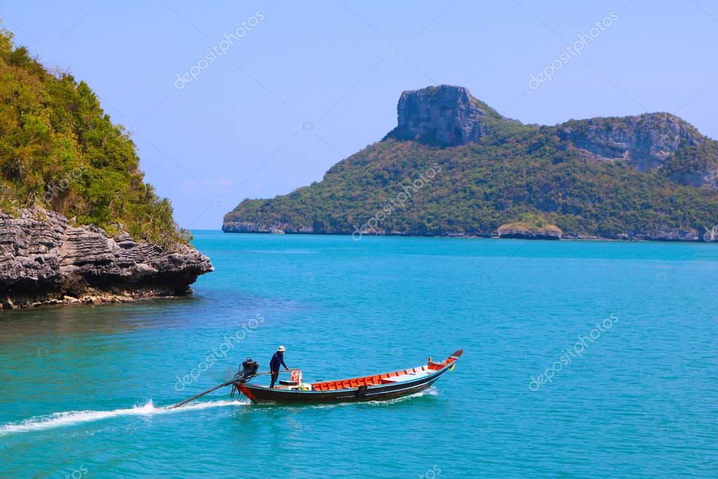 long-tail boat at archipelago island.
