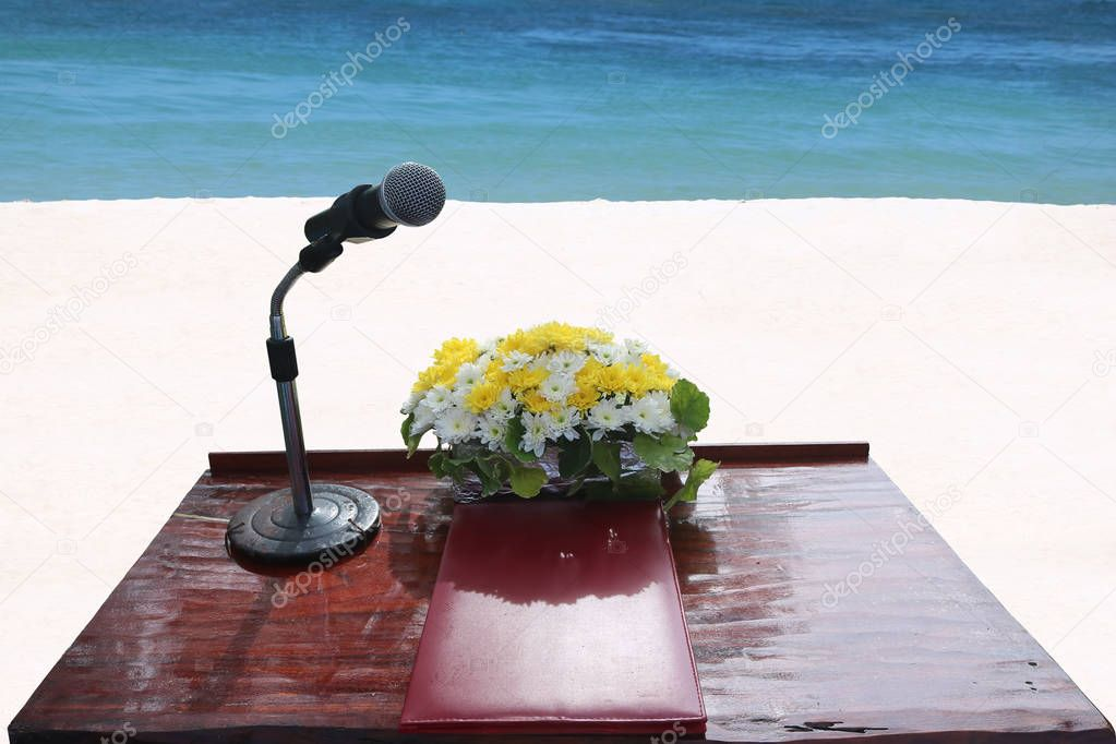 The podium and microphone for ceremony on the beach