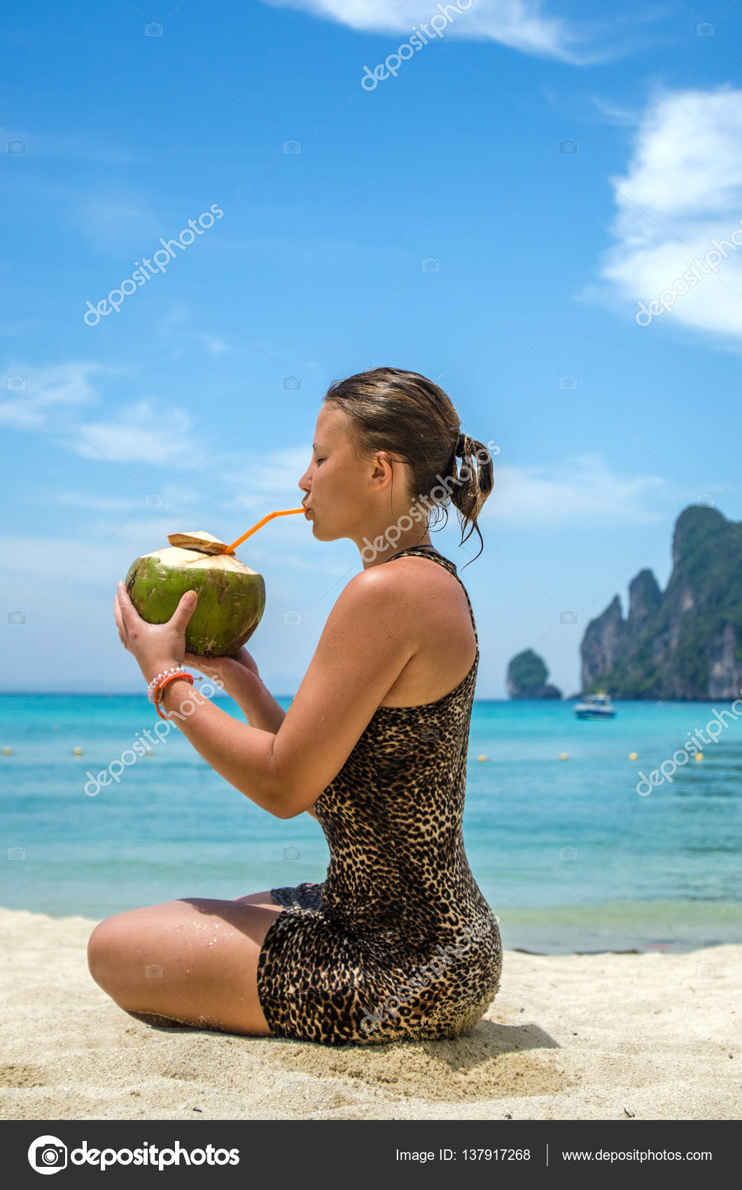 Young Beautiful Woman Drinking Coconut Water On Tropical Beach Of Phi Don Island Thailand