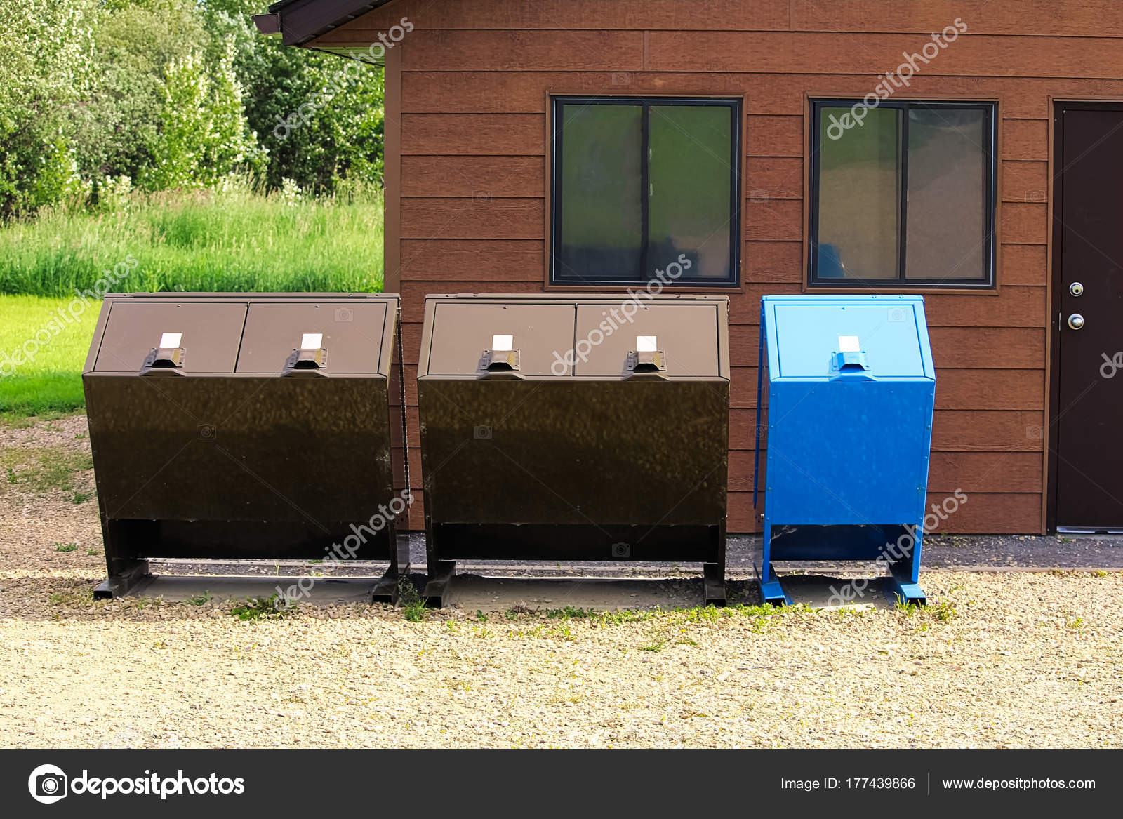 Four bear proof garbage cans with a recycle bin — Stock Photo