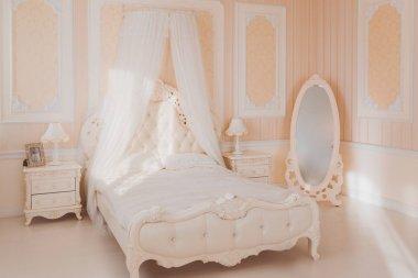 White interior of luxury bedroom