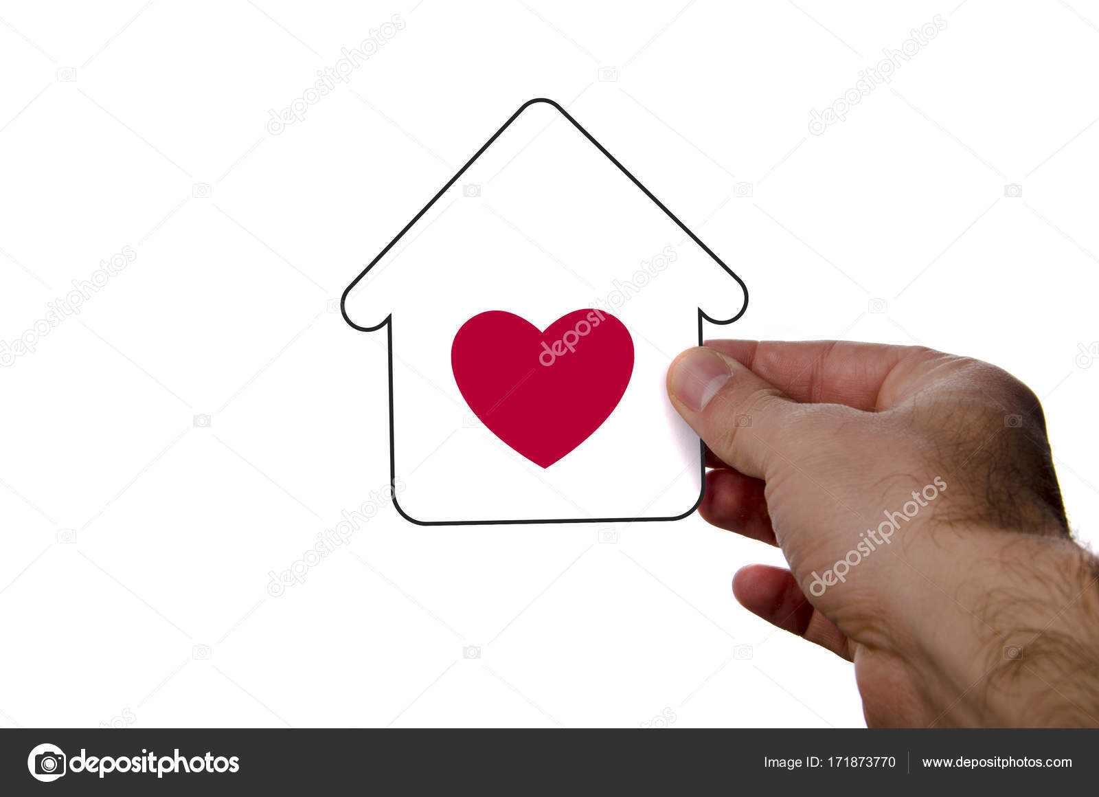 Isolated Hand Holding Dream House Icon With Red Heart Over A Whi