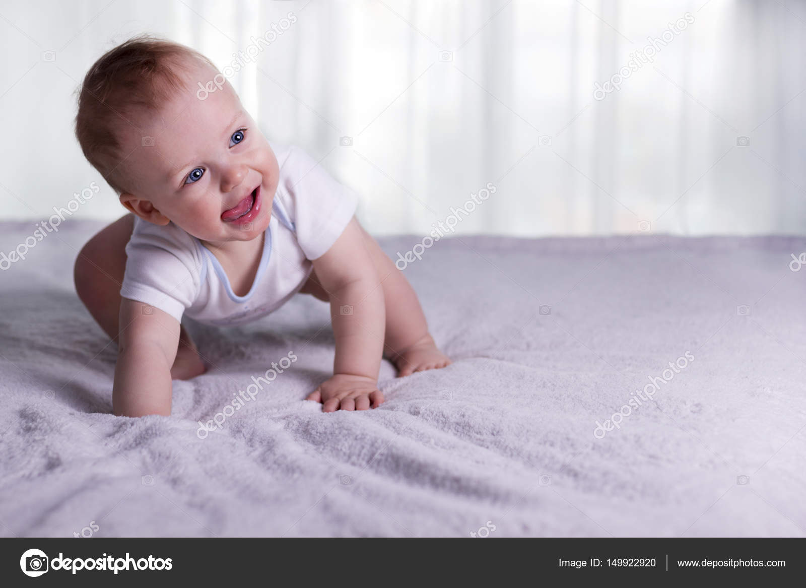 first steps of funny baby boy. cute infant kid begining to toddle