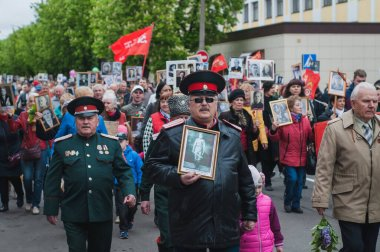 Belarus, the city of Bobruisk - May 9, 2019.  The Immortal regiment procession in Victory Day.  People go to the central square with flags and portraits in memory of the soldiers of World War II.