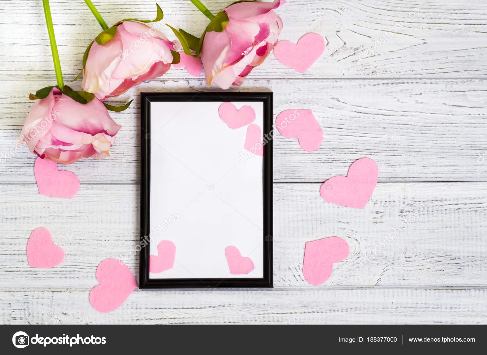Empty Dark Frame Decorated With Pink Hearts And Pink Flowers Stock