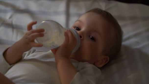 footage baby eating baby food from a bottle. 4k