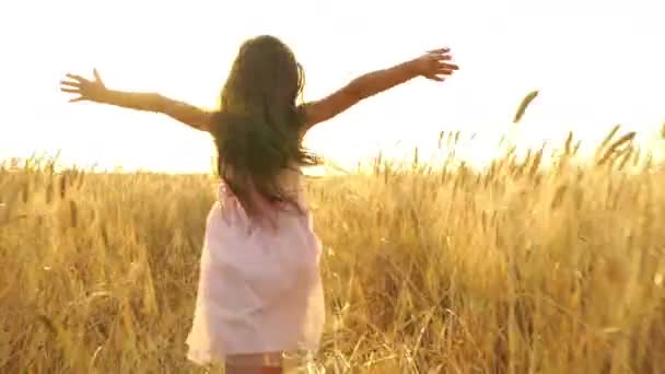 young girl in the dress is running across the field.