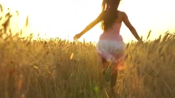 pretty girl in the dress is running across the field.