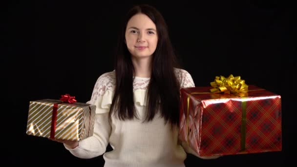 Young woman with a gift box on black background. gift box with white ribbon for Happy New Year, Merry Christmas, Valentines Day, birthday.