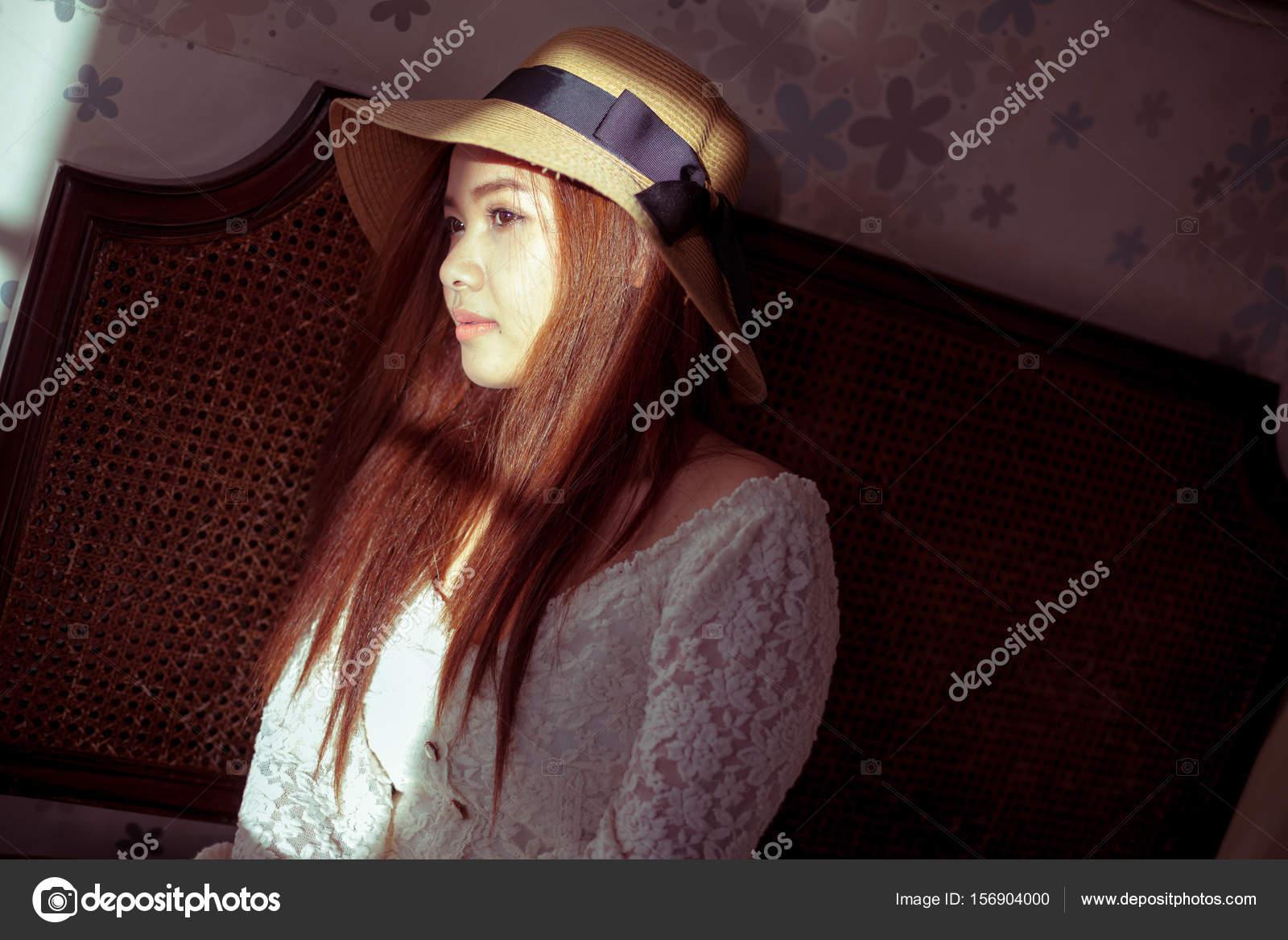 Sad Asian Vintage Woman On The Window Stock Photo