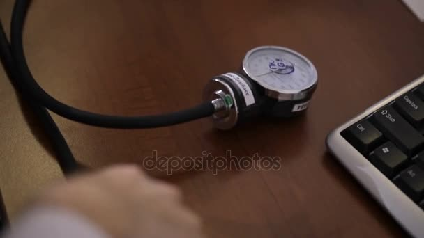 Close up of a doctor using a blood pressure gauge on a patient to check on his health