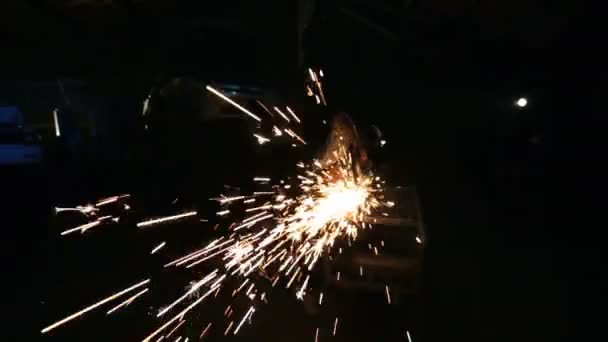 Sparks from the angle drive grinder against a dark background