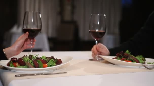 Couple with wine glasses dating and toasting in restaurant
