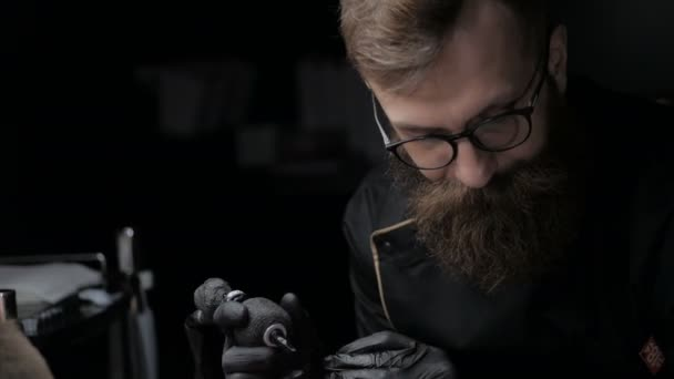 Professional tattoo artist showing the process of doing tattoo on back