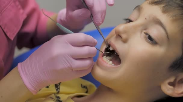 Child patient sitting on dental chair in paediatric dentists office