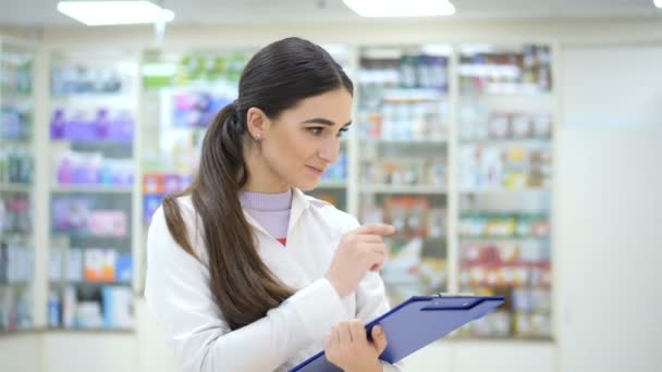 A young girl promoter makes a reconciliation of drugs in a pharmacy