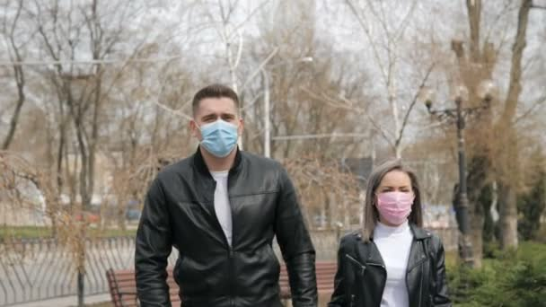 Portrait of a couple of european appearance with medical masks in park