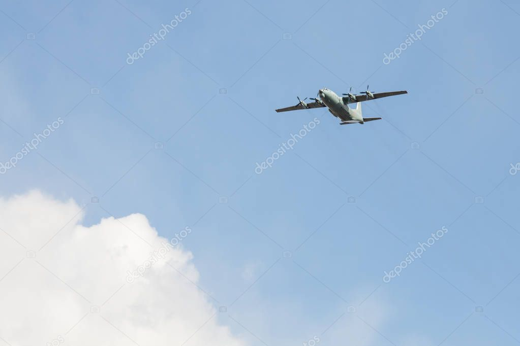 Old Soviet military turboprop cargo plane flies over the city in the may 9 victory day