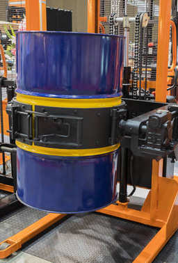 Drum lifted by drum stacker
