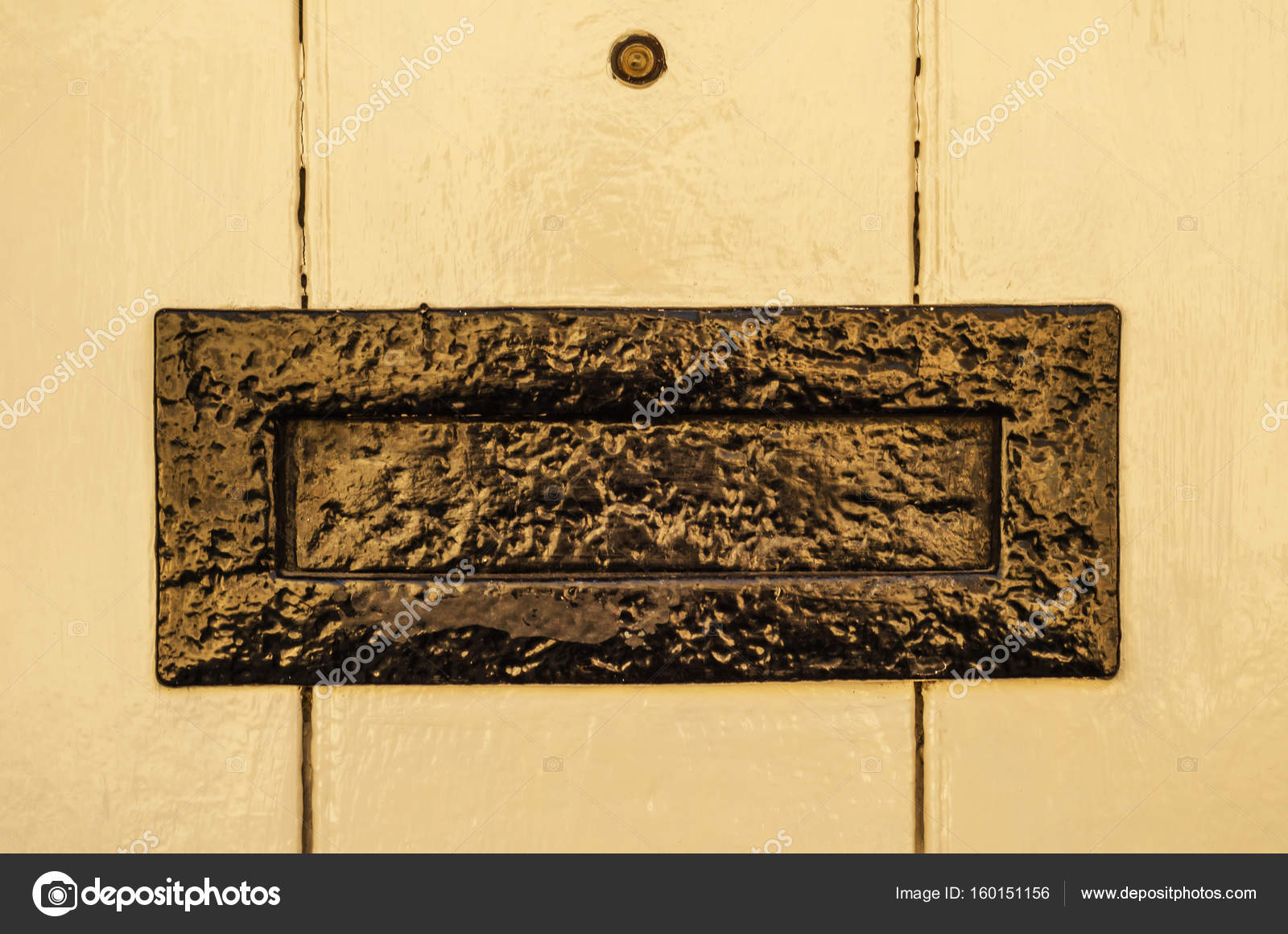 Old letterbox in the door traditional way of delivering letters old letterbox in the door traditional way of delivering letters stock photo spiritdancerdesigns Images