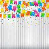 Colorful confetti and party flags on white wall background.