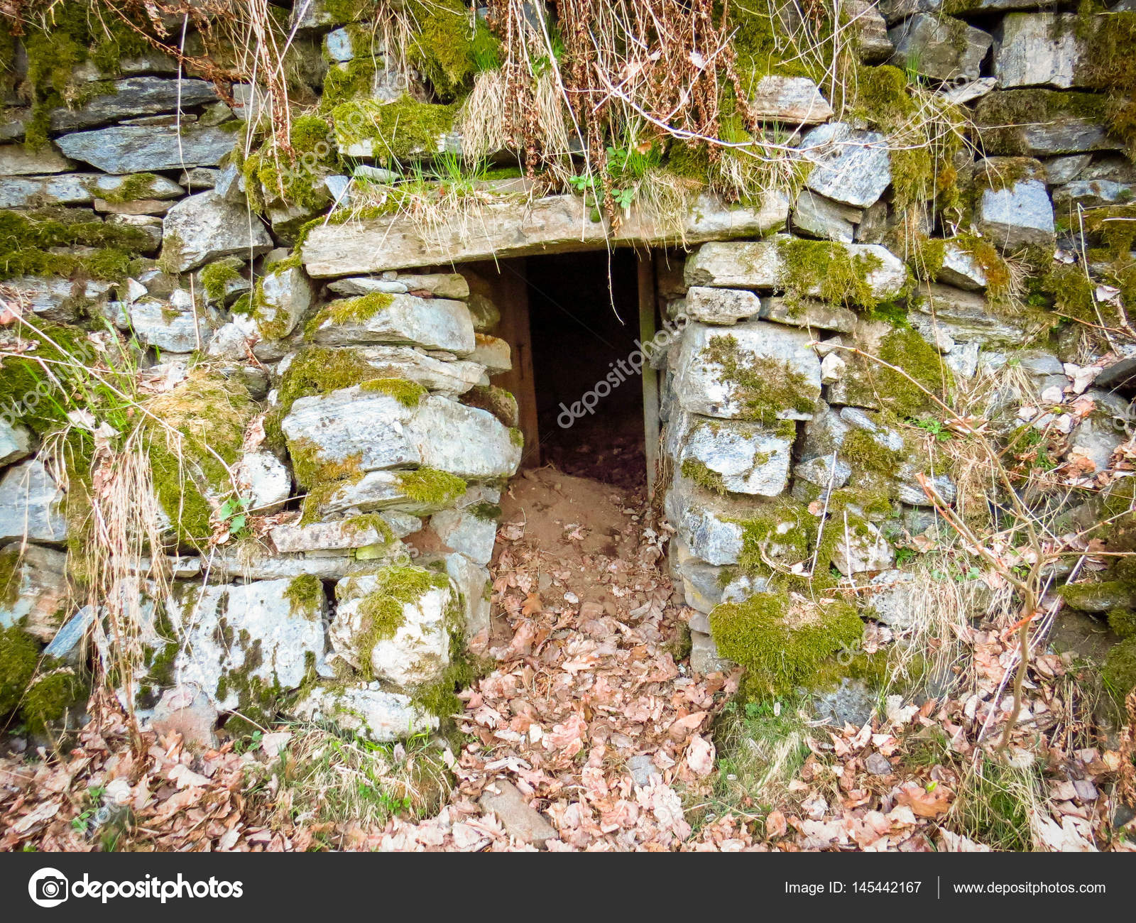 Door to an old abandoned stone cellar in Flaten at Nes Verk in Tvedestrand Aust-Agder Norway u2014 Photo by lillitve & Entrance to an old abandoned stone cellar in Tvedestrand Norway ...