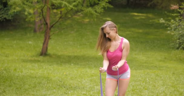 Young girl exercising in the park.
