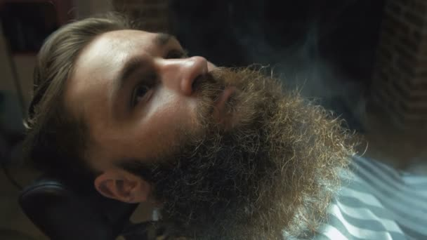 Shaving process of beards in Barbershop. Steam shave