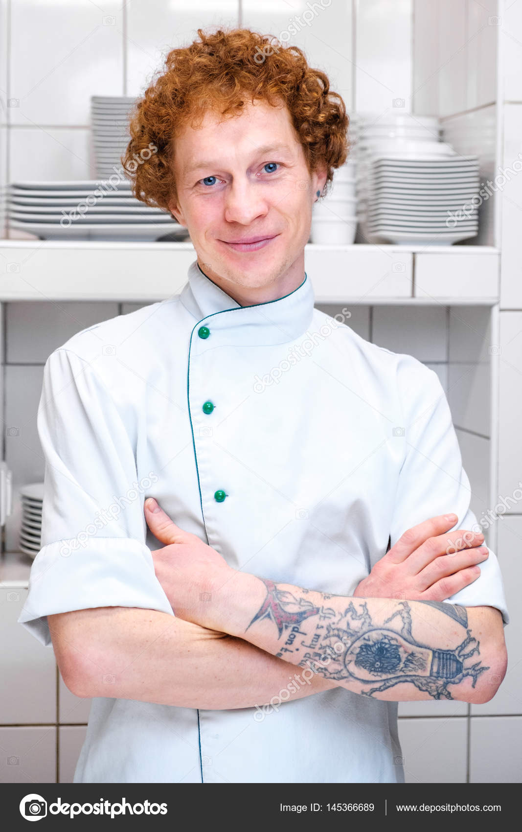 A chef with red hair and a tattoo on his arm in the kitchen — Stock ...