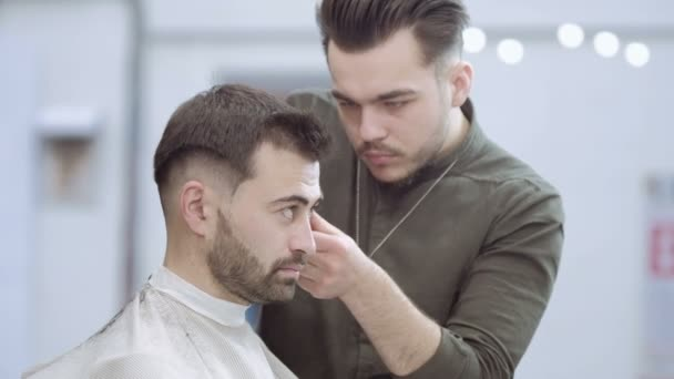 Master Cuts Hair And Beard Of Men In The Barbershop Hairdresser