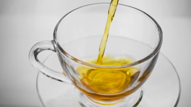 Green tea. Pouring tea into a glass cup. Slow motion. High speed camera shot. Full HD 1080p
