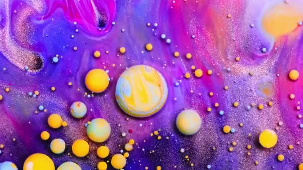 Bubble liquid floats in a paint. Mixing of paint, oil and milk. Gorgeous colorful and bright background, cosmetic effect. Abstract colorful paint and slow motion.