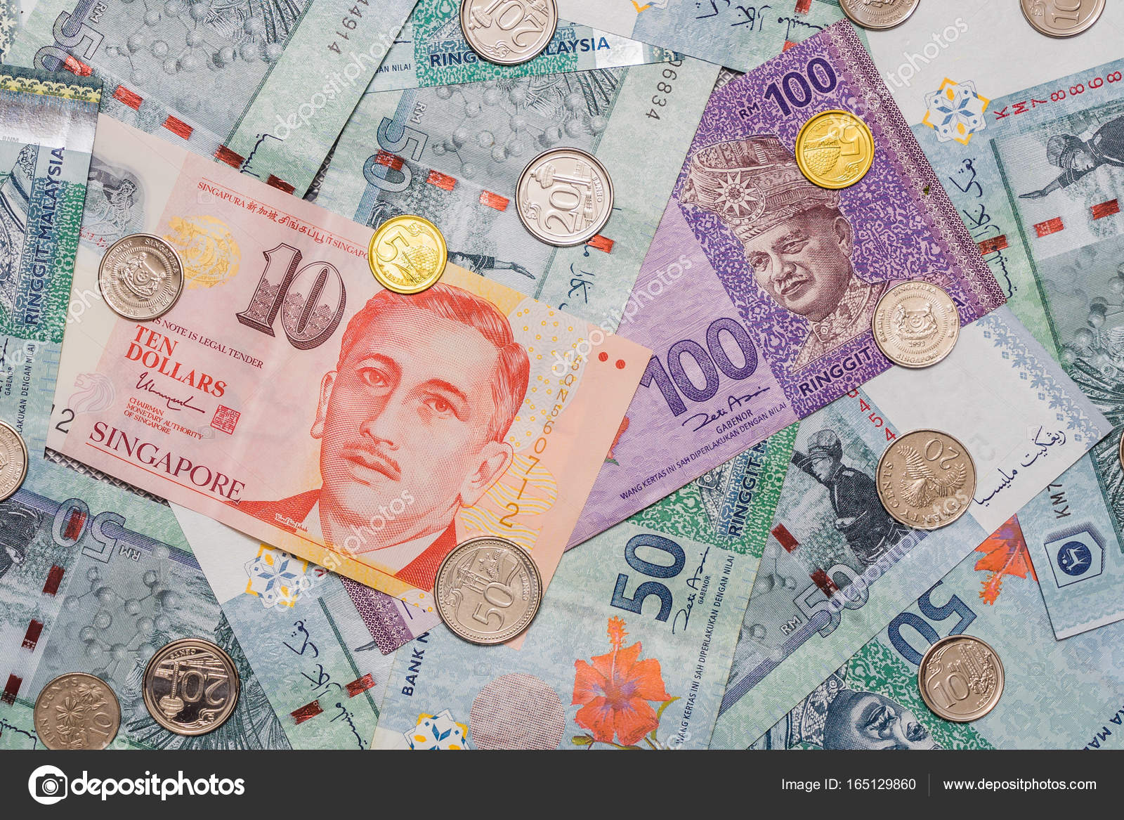 Singapore Dollar On Top Of Malaysian Ringgit Currency On Backgro