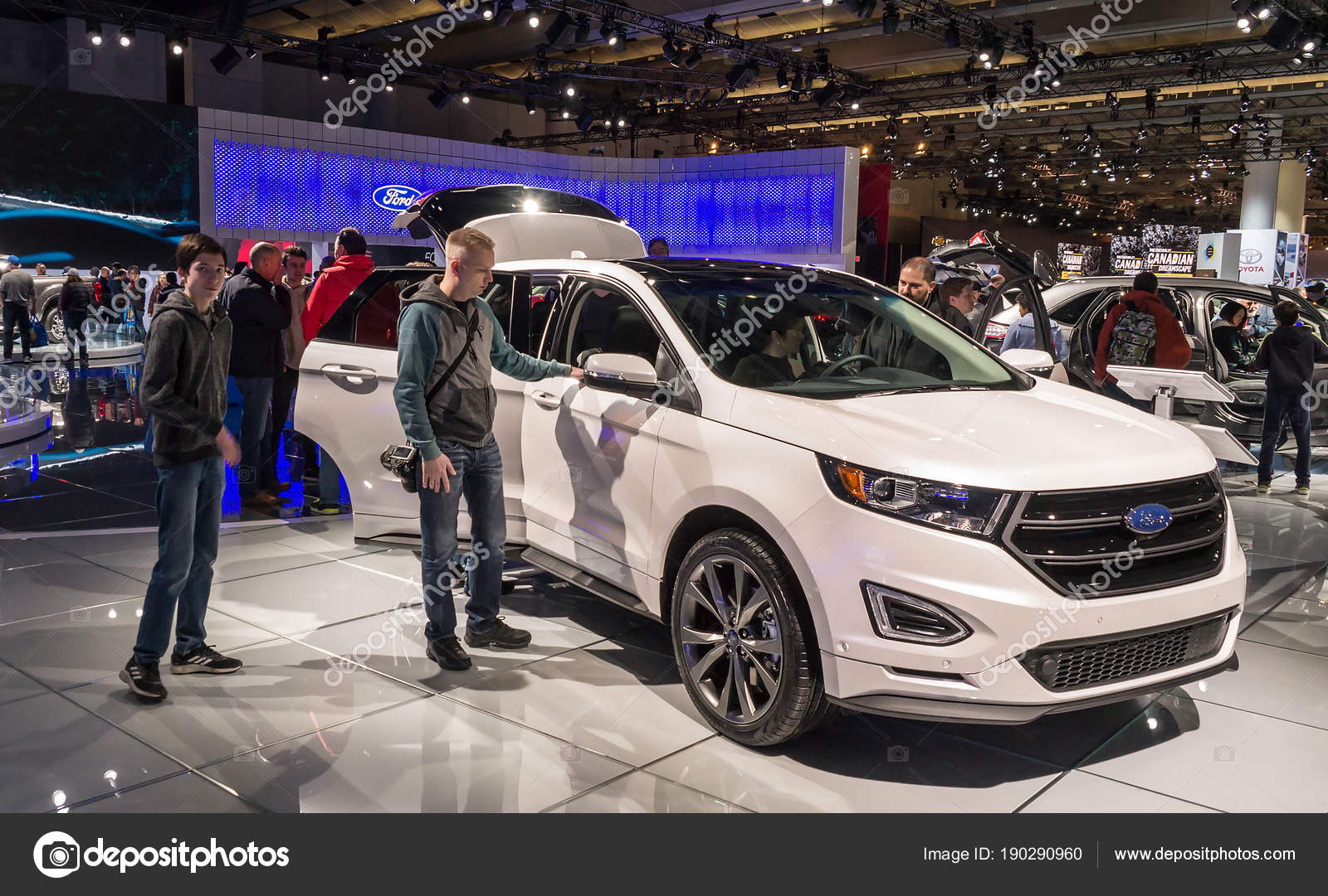 Toronto Canada  Visitors Of  Canadian International Autoshow Beside The New Ford Edge Sport Suv On The Ford Motor Company Exposition