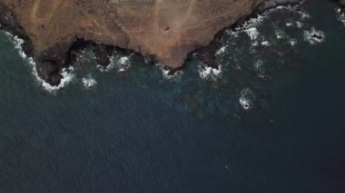 video of waves lapping a rocky shore in Tenerife
