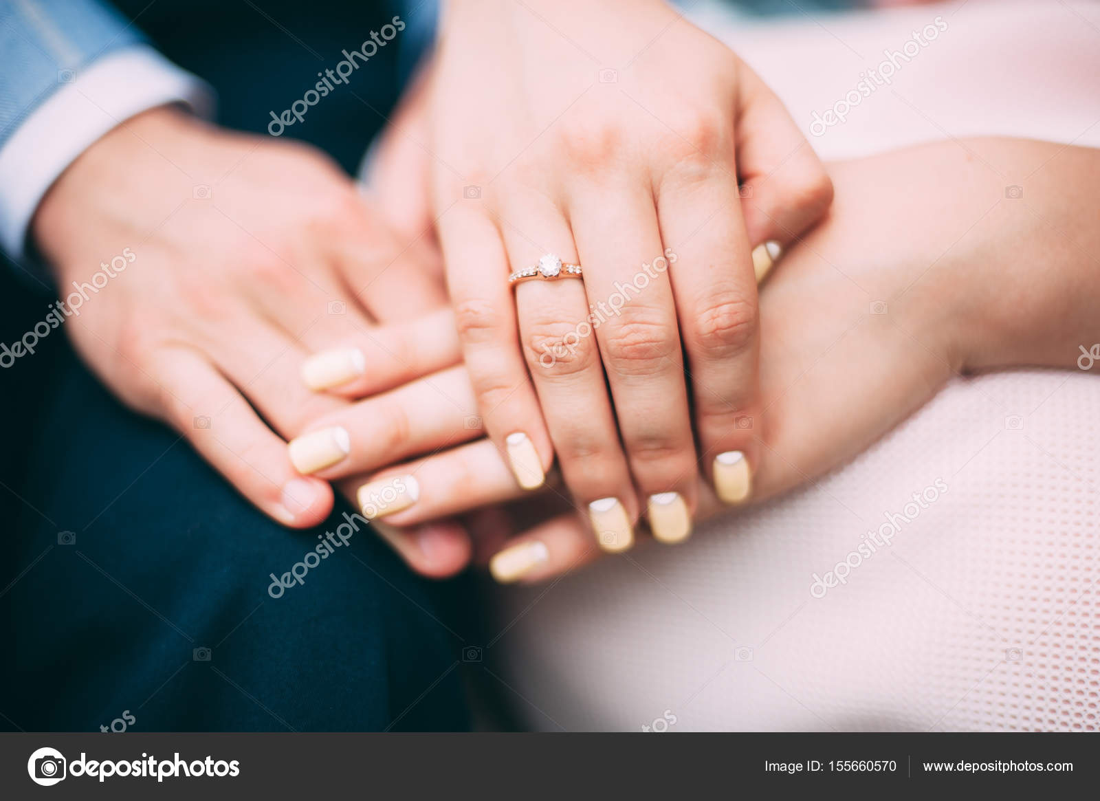 Touches hands of lovers. Wedding ring with diamond. advertising ...