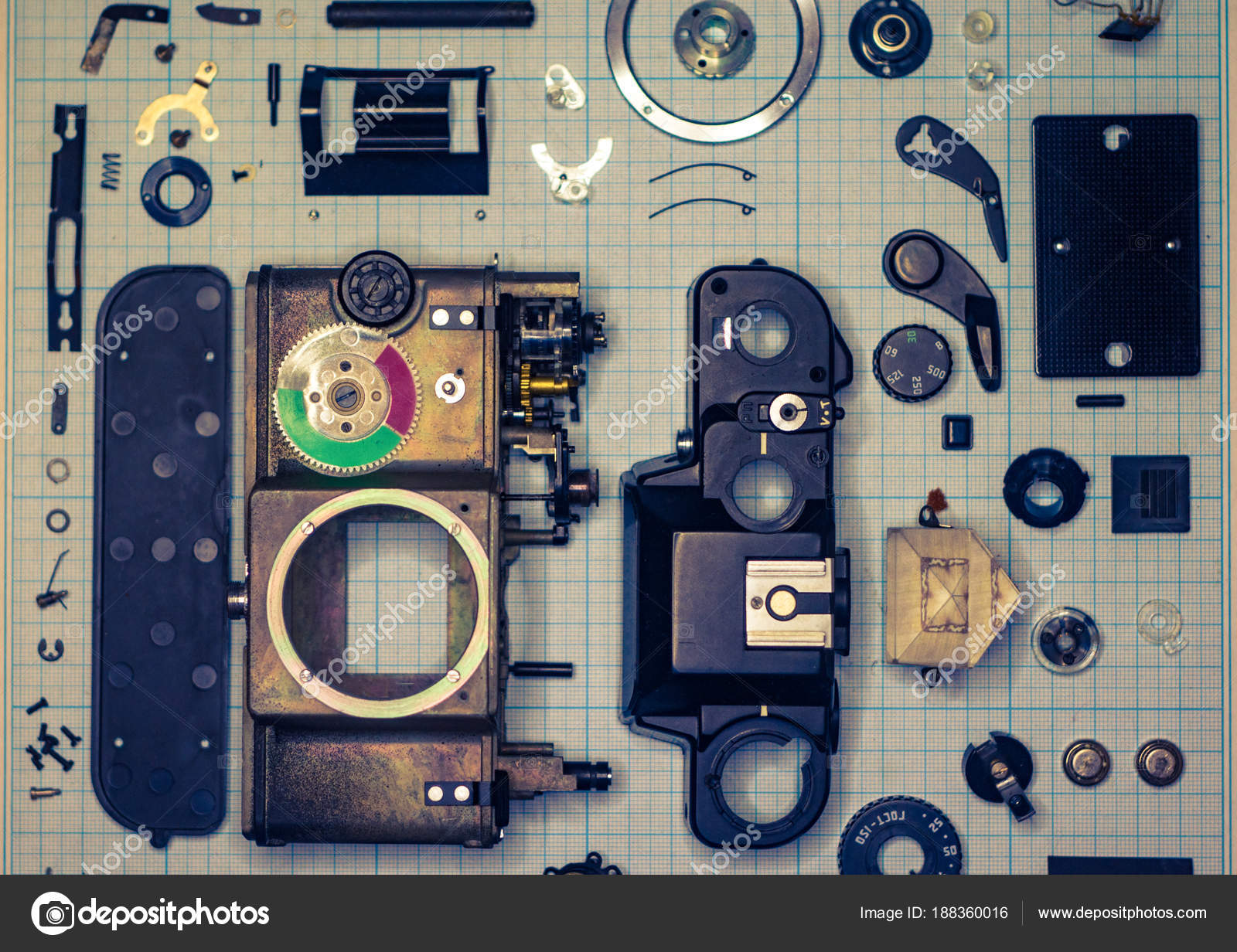 parts old retro film slr camera on graph paper stock photo