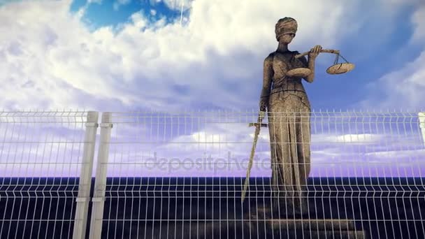 Greek goddess of law and justice behind wire fence