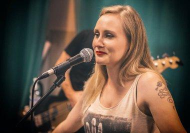 Beautiful caucasian female singer in studio