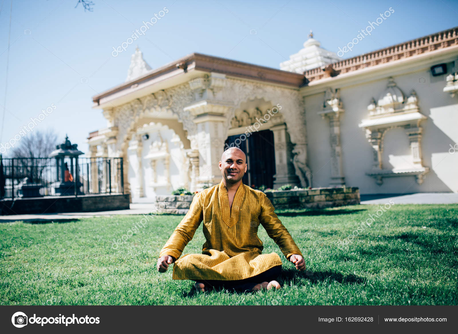 Handsom Indian Man Greeting Namaste In Gold Kurta At The Temple